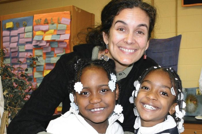 Elizabeth Seebeck with two Montessori students